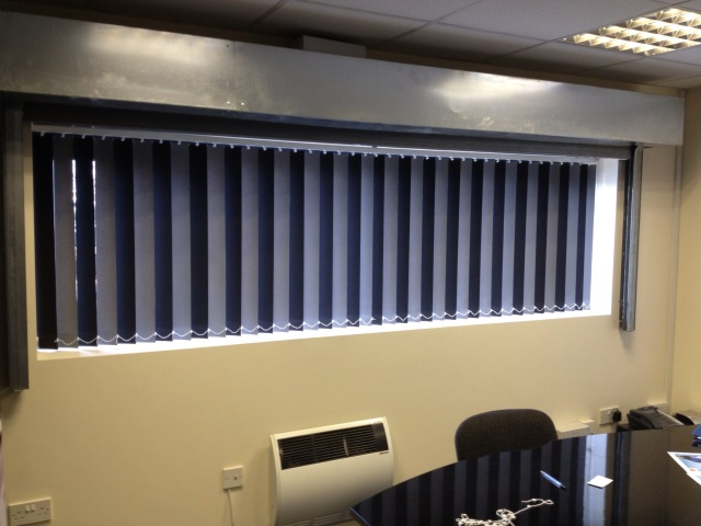 Vertical Blinds With Alternating Black And Grey Fabric